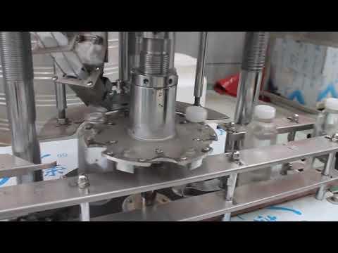 自動シングルヘッドプラスチックボトルロータリーキャッピングマシン
